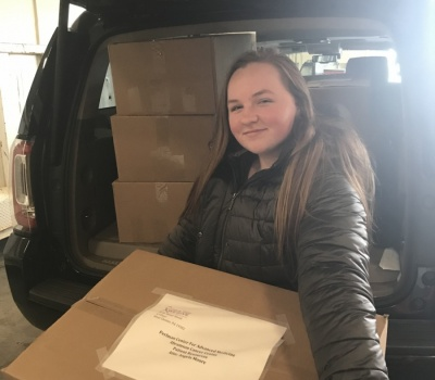 Cancer Comfort Kit and Busy Bag packing the car
